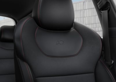 Leather high-performance N Line sport seats with red stitching.