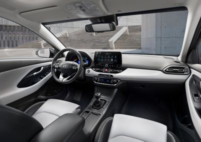 Front interior of the new Hyundai i30 as seen from the back seat
